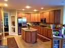 Huge island kitchen from breakfast - 42596 IRON BIT PL, CHANTILLY
