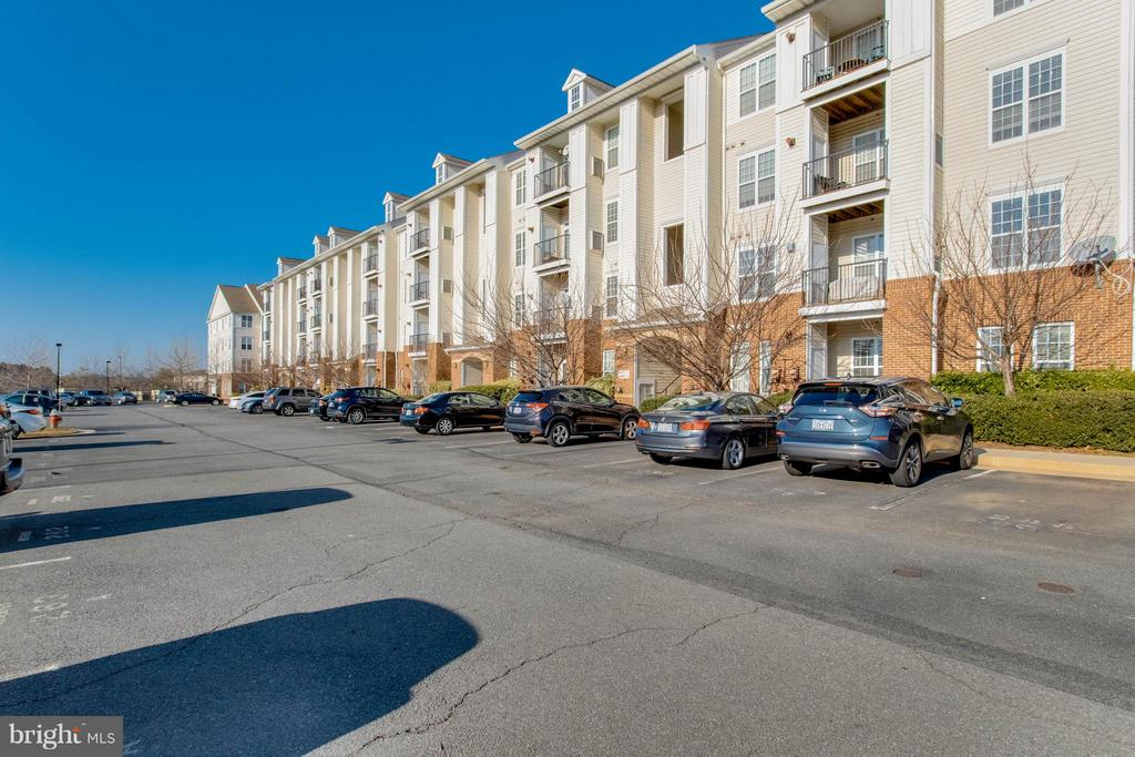 Parking lot- 2 assigned spaces - 21228 MCFADDEN SQ #111, STERLING