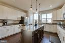wrap around cabinetry and granite counters - 1456 TRAFALGAR LN, FREDERICK