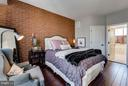 Master bedroom with exposed brick - 1456 TRAFALGAR LN, FREDERICK