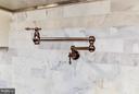 Marble back splash tile and bronze pot filler - 5531 30TH PL NW, WASHINGTON