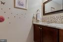 Updated powder room on main level - 4933 CASIMIR ST, ANNANDALE