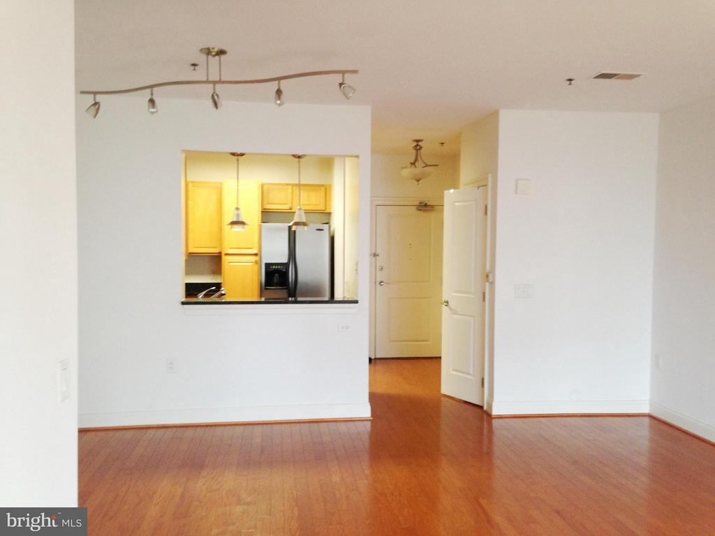 View of dining area and kitchen from living room - 38 MARYLAND AVE #214, ROCKVILLE