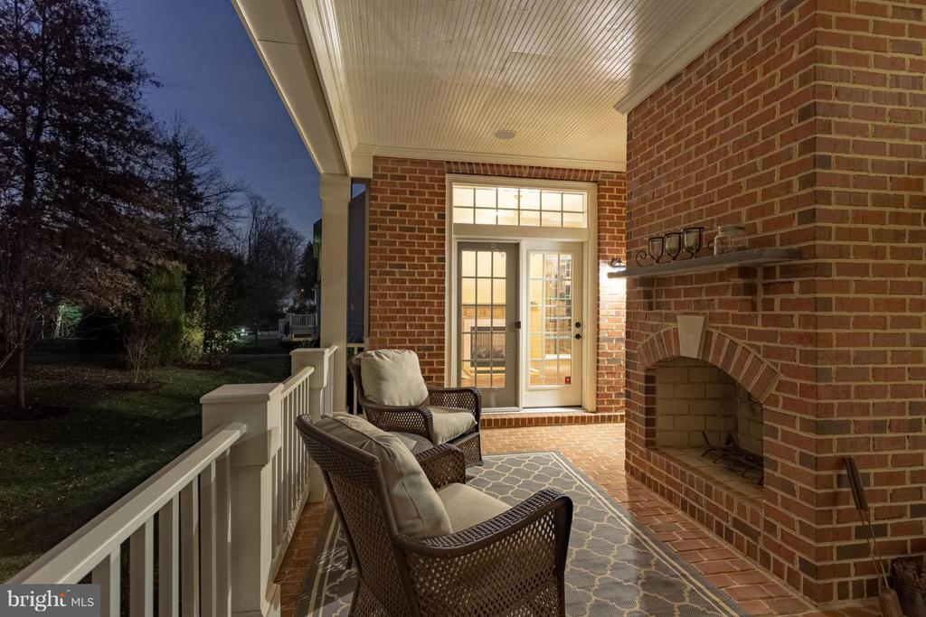 Side Porch with Fireplace off Library - 8518 WEDDERBURN STATION DR, VIENNA