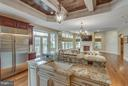 Gourmet Kitchen with View of Family Room - 8518 WEDDERBURN STATION DR, VIENNA