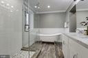 En Suite Bathroom with Wood Look Porcelain Tile - 7821 FORT HUNT RD, ALEXANDRIA