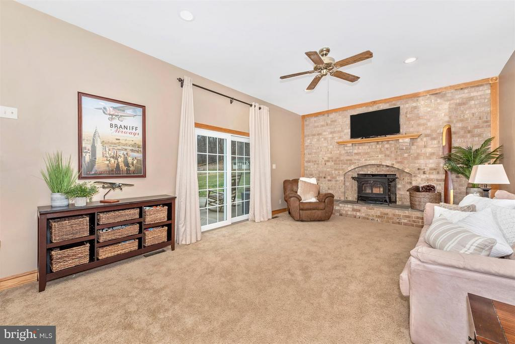 Step down to family rm w/Encore cast iron wdstove. - 10538 CHURCH HILL RD, MYERSVILLE