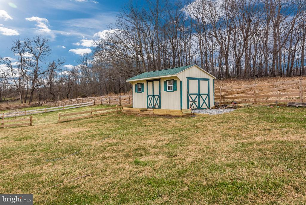 Storage shed conveys with the property. - 10538 CHURCH HILL RD, MYERSVILLE