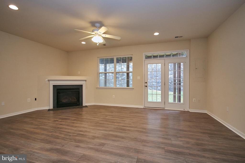 Lower Level Recreation Room with Gas Fireplace - 9738 CORBETT CIR, MANASSAS PARK