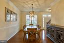 Custom chandelier conveys. Chair and crown molding - 7131 MASTERS RD, NEW MARKET