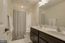 Hall guest bath with dual sinks - 7131 MASTERS RD, NEW MARKET