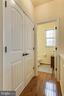 Main level powder room with hardwood floors - 7131 MASTERS RD, NEW MARKET