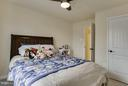 Spacious guest bedroom w craftsman doors & fan - 7131 MASTERS RD, NEW MARKET