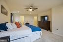 Master suite with lighted ceiling fan - 7131 MASTERS RD, NEW MARKET