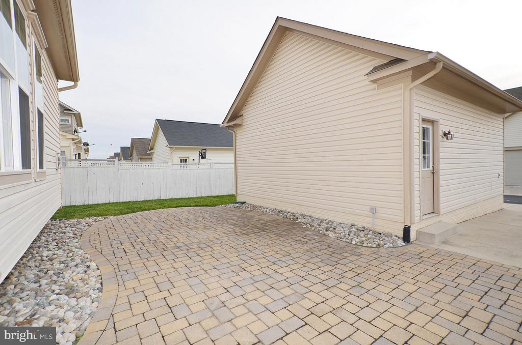 Brick Paver Patio to Detached Garage - 23386 HIGBEE LN, BRAMBLETON
