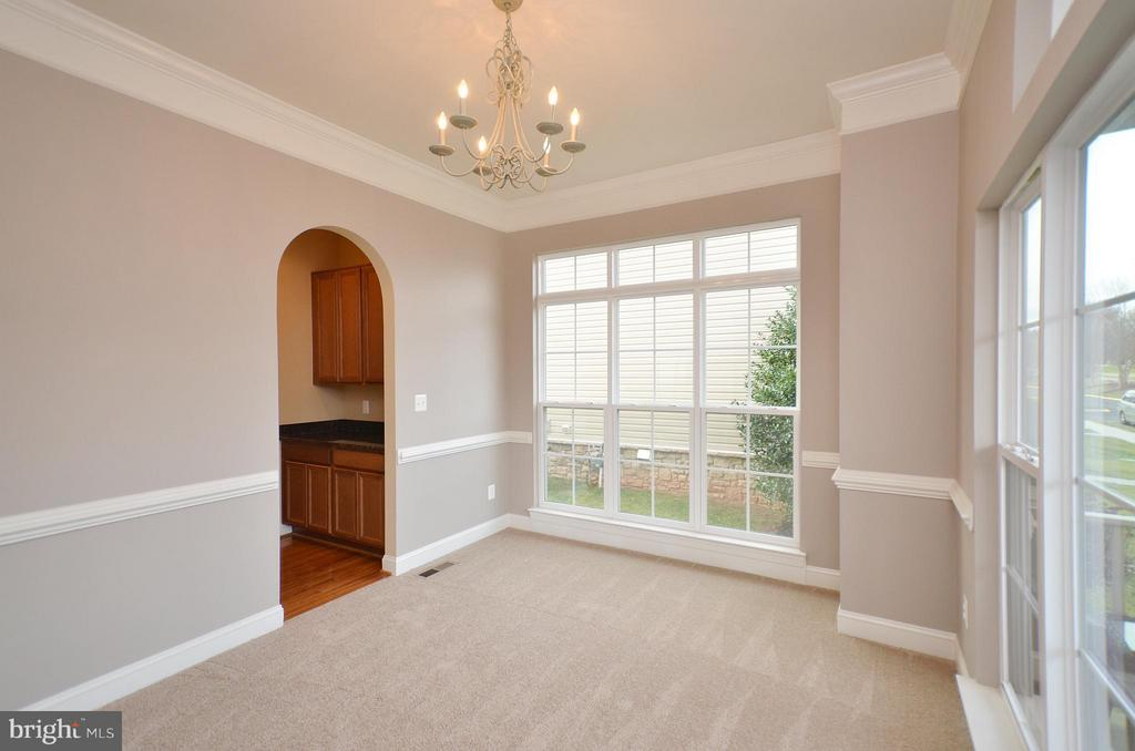Dining Room with Crown & Chair Rail Moldings - 23386 HIGBEE LN, BRAMBLETON