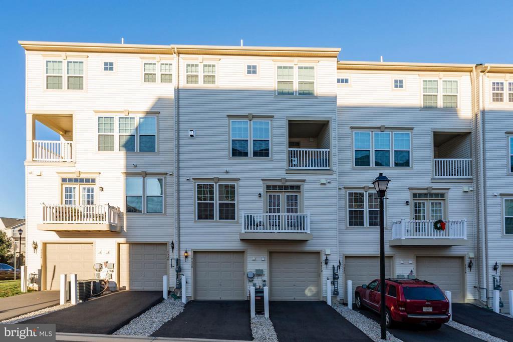 Exterior Rear of Home + Outdoor Balcony - 7530 BRUNSON CIR, GAINESVILLE