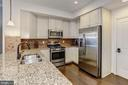 Kitchen - Hardwood Floors and Loads of Cabinets - 7530 BRUNSON CIR, GAINESVILLE