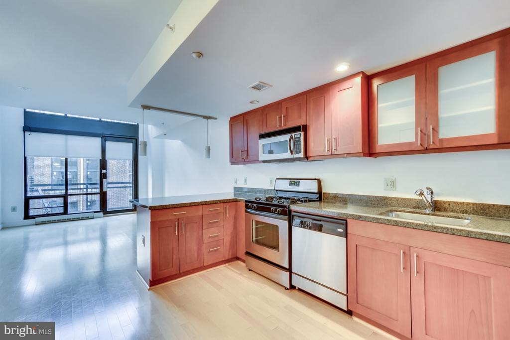 View of kitchen and combined living/dining - 912 F ST NW #504, WASHINGTON