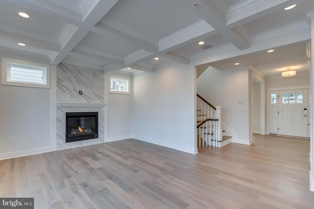 Family room with Coffered ceiling & gas fireplace - 4525 FAIRFIELD DR, BETHESDA