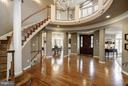 A gracious, curved stairway leads to upper gallery - 3942 27TH RD N, ARLINGTON
