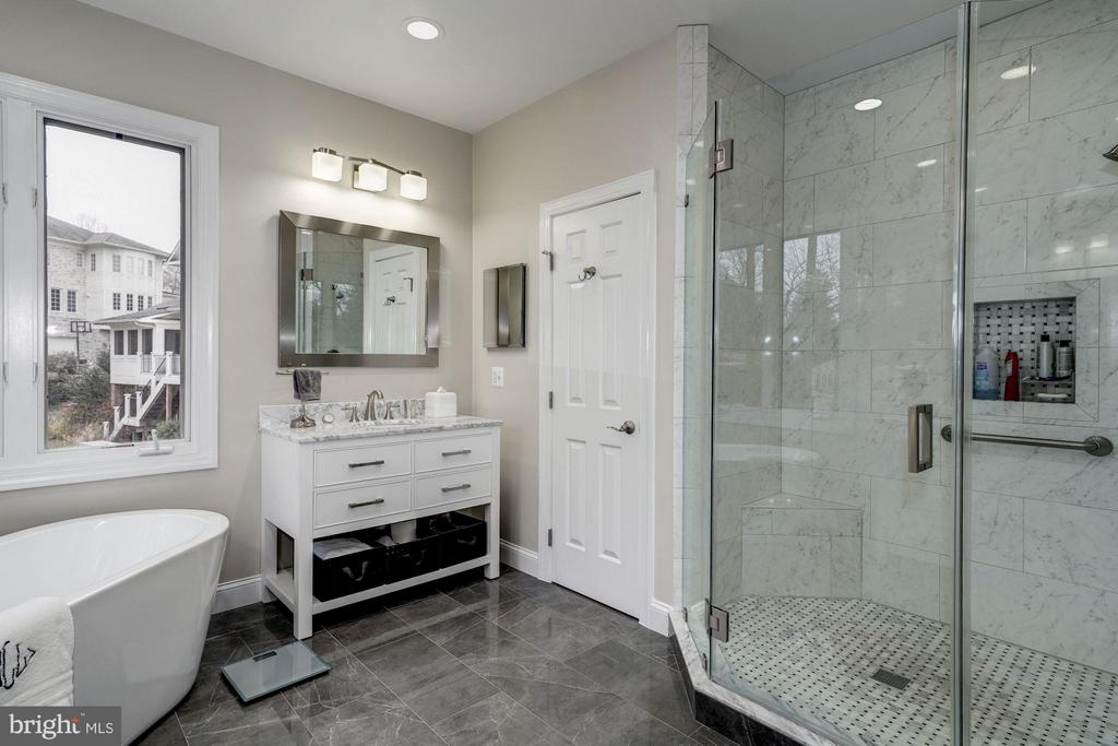 The master bath features two toilet closets - 3942 27TH RD N, ARLINGTON