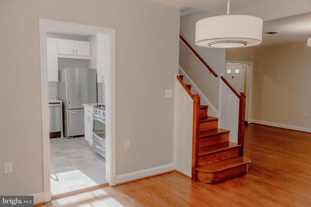 Main floor kitchen entrance and stairwell. - 2005 NE LAWRENCE ST NE, WASHINGTON