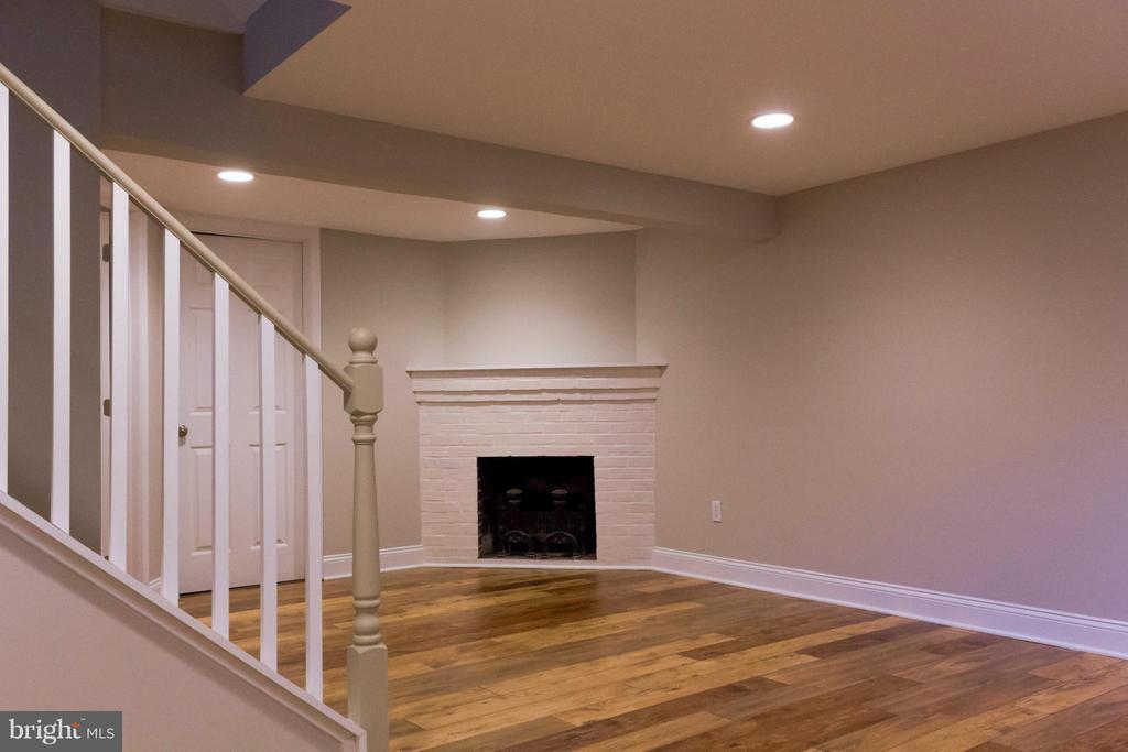 Basement family room with fireplace. - 2005 NE LAWRENCE ST NE, WASHINGTON