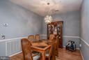 Dining Room with Gorgeous Lighting and Chair Rail - 85 LEGEND DR, FREDERICKSBURG