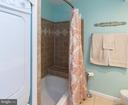 Lovely warm-tone ceramic tile; bath with seat - 4050B GRAYS POINTE CT, FAIRFAX