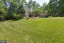 The open area is surrounded with perennial gardens - 7111 TWELVE OAKS DR, FAIRFAX STATION