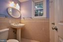 Lower level bath with a window to backyard - 3421 BEAUFORD CIR, ANNANDALE