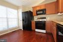 Kitchen with table space and granite counters - 344 STALLION SQ NE, LEESBURG