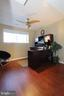 Lower level 4th bedroom with hardwood floors - 344 STALLION SQ NE, LEESBURG