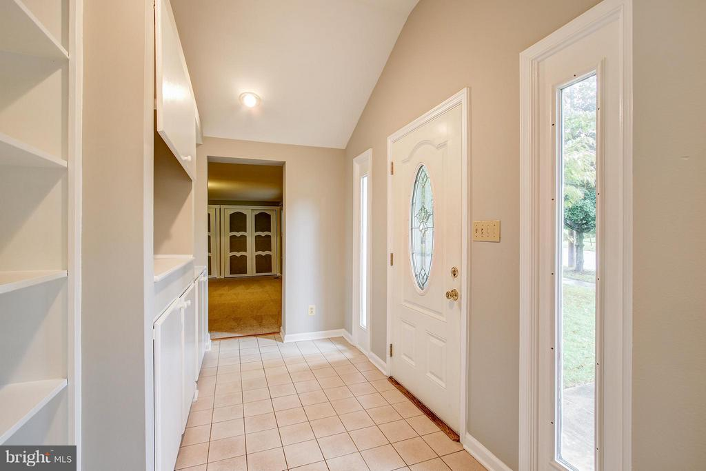 Front foyer with built ins - 717 WOODBURN RD, ROCKVILLE