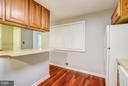 Kitchen with small storage area - 717 WOODBURN RD, ROCKVILLE