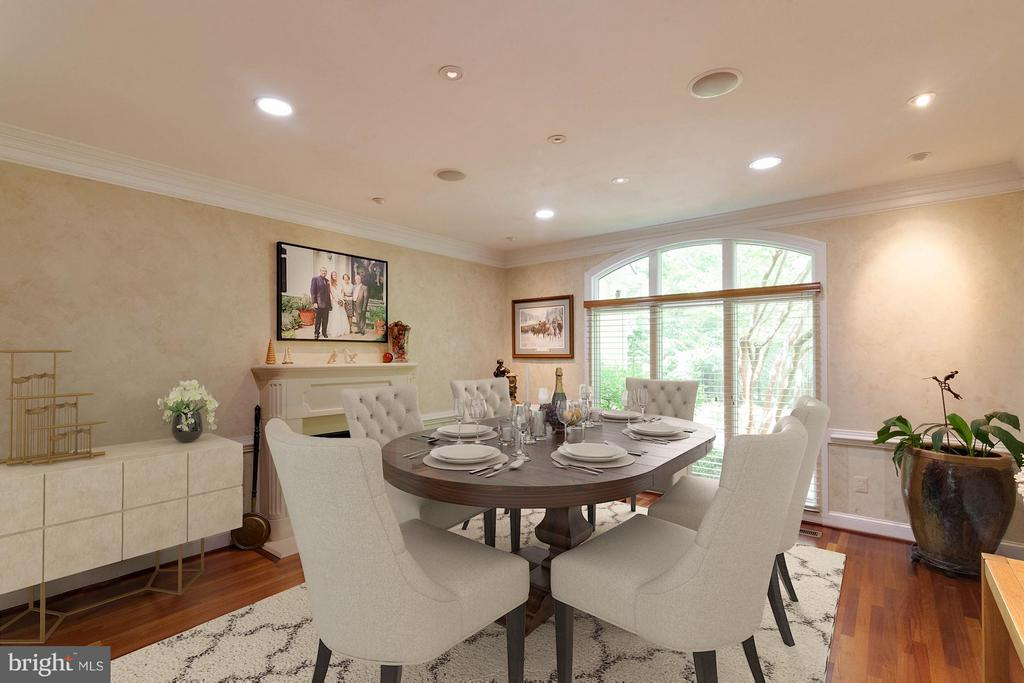 Spacious formal dining room  has a gas fireplace - 7111 TWELVE OAKS DR, FAIRFAX STATION