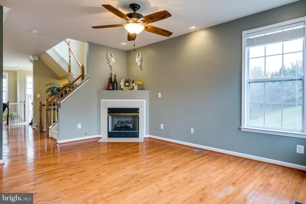 Spacious Family Rm. off Kitchen w/ Gas Fplc. & HW - 21018 ROAMING SHORES TER, ASHBURN