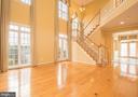 Two-Story Living Room with Hardwoods - 21844 WESTDALE CT, BROADLANDS