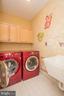 Laundry Room with Upgraded Washer/Dryer & Sink. - 21844 WESTDALE CT, BROADLANDS