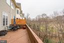 Deck overlooking Trump National Golf Club - 20374 FALLSWAY TER, STERLING