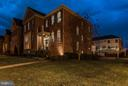 Twilight showcases majestic brick home - 164 CROWN FARM DR, GAITHERSBURG