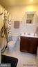 4TH LEV EN-SUITE FULL BA. TILE FLOOR/TUB SURROUND - 3007 ESKRIDGE RD, FAIRFAX