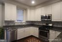 KITCHEN W/STAINLESS APPLIANCES, HARDWOOD FLOORING - 3007 ESKRIDGE RD, FAIRFAX