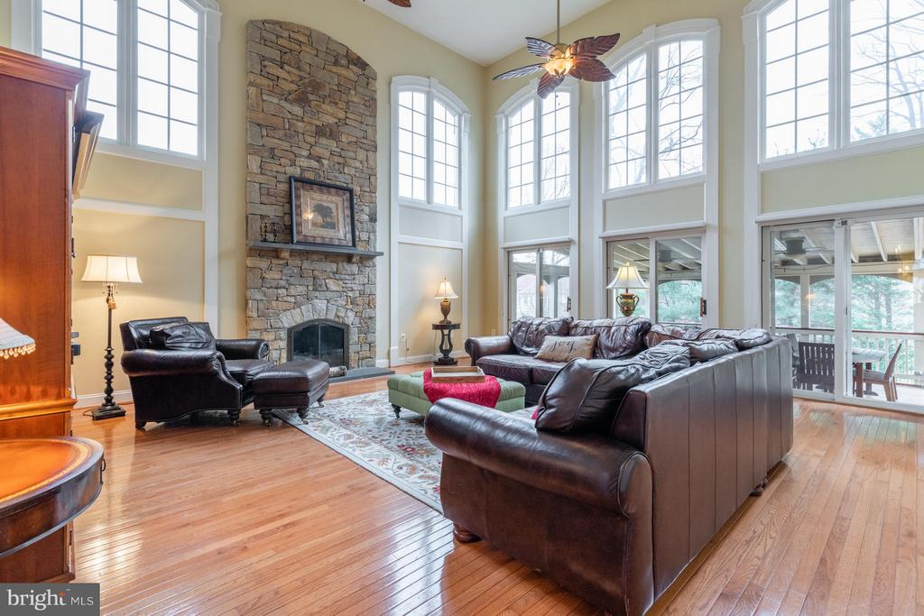 Two Story Family Room with Stone Fireplace - 3013 ROSE CREEK CT, OAKTON