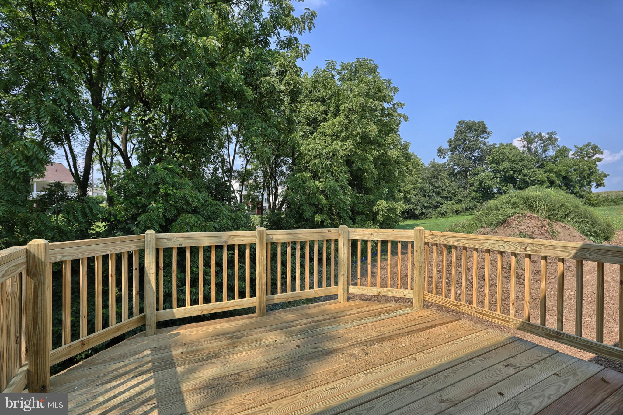 Deck or concrete patio depending on elevation.