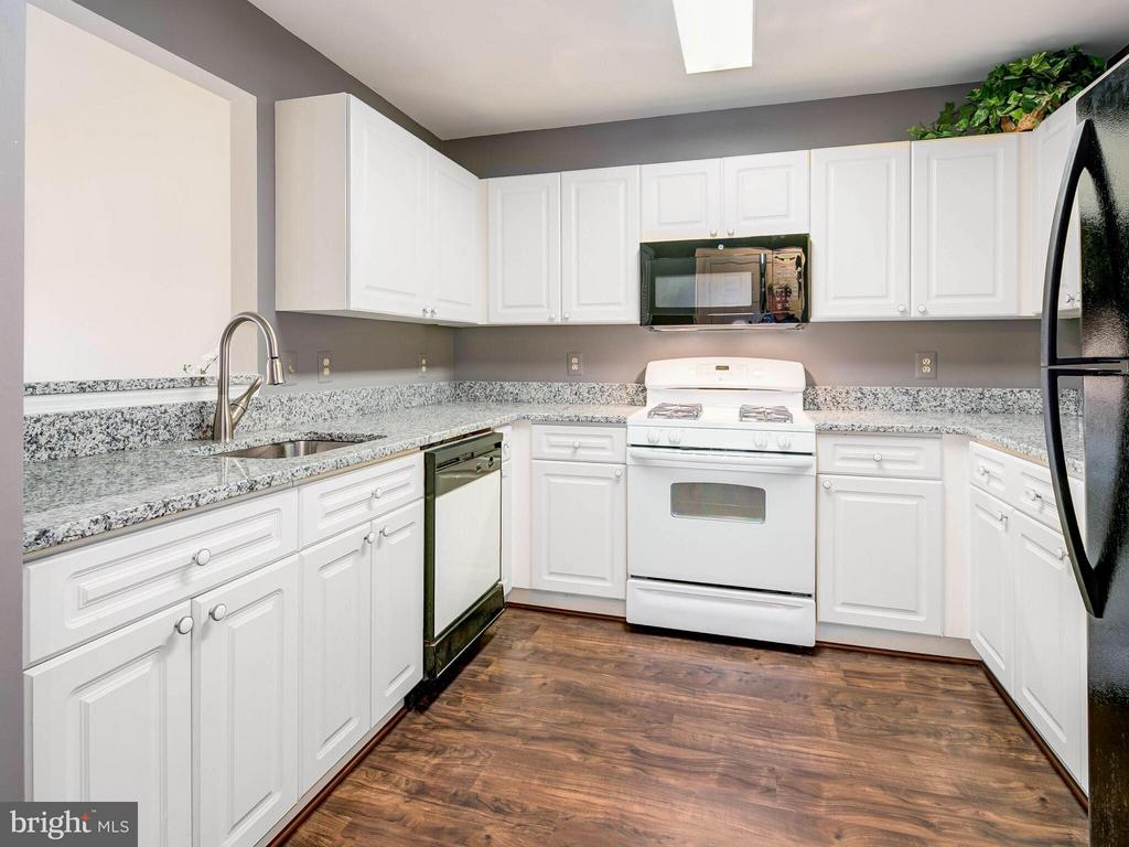 Kitchen with New Flooring - 20576 SNOWSHOE SQ #302, ASHBURN