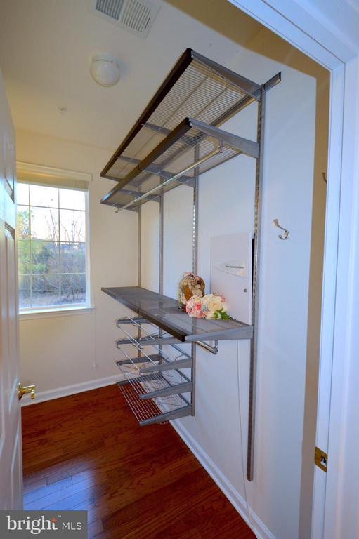 Custom shelving in master walk-in closet #1 - 20365 BELMONT PARK TER #104, ASHBURN