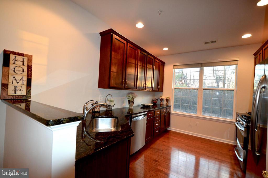 Kitchen -recessd lights & window- plenty of light! - 20365 BELMONT PARK TER #104, ASHBURN