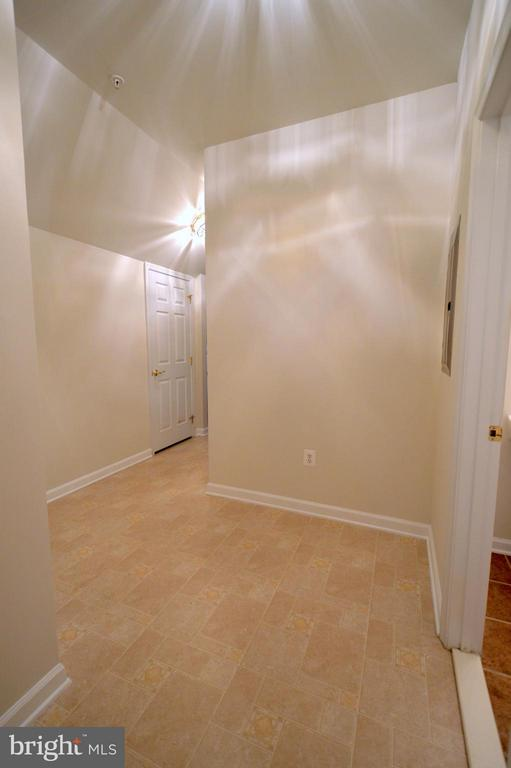 Mud room separated from living room area views - 20365 BELMONT PARK TER #104, ASHBURN
